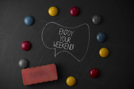Handwriting text writing Enjoy Your Weekend. Conceptual photo wishing someone that something nice will happen at holiday Round Flat shape stones with one eraser stick to old chalk black board