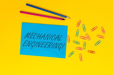 Writing note showing Mechanical Engineering. Business concept for deals with Design Manufacture Use of Machines Blank paper sheet message reminder pencils clips colored background Imagens - 124403778
