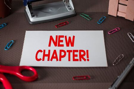 Text sign showing New Chapter. Business photo text Starting ultimately something goals created in your mind Scissors and writing equipments plus plain sheet above textured backdrop Stok Fotoğraf