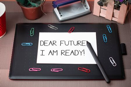 Conceptual hand writing showing Dear Future I Am Ready. Concept meaning state action situation being fully prepared Scissors and equipments math book above textured backdrop