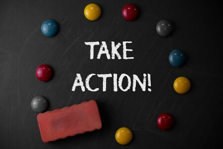 Word writing text Take Action. Business photo showcasing do something official or concerted to achieve aim with problem Round Flat shape stones with one eraser stick to old chalk black board