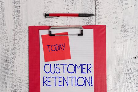 Writing note showing Customer Retention. Business concept for Keeping loyal customers Retain analysisy as possible Clipboard paper sheet sticky note ballpoint vintage wooden background
