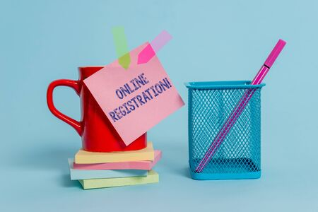 Handwriting text writing Online Registration. Conceptual photo Process to Subscribe to Join an event club via Internet Cup note arrow banners stacked pads metal pen holder pastel background