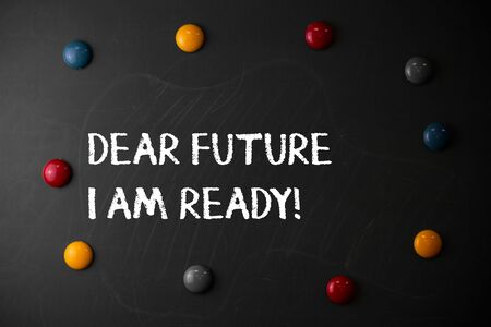 Text sign showing Dear Future I Am Ready. Business photo showcasing state action situation being fully prepared Round Flat shape stones with same sizes stick to old chalk black board