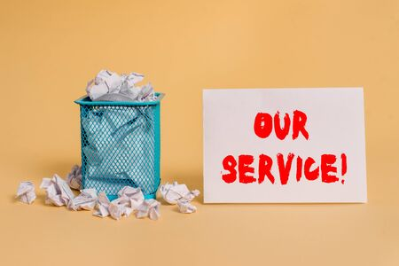 Handwriting text Our Service. Conceptual photo announcing as repair or provide maintenance for product crumpled paper trash and stationary with empty paper placed in trash can Stock Photo