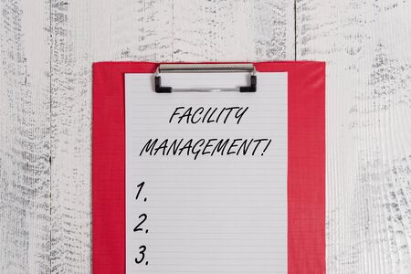 Text sign showing Facility Management. Business photo text Multiple Function Discipline Environmental Maintenance Colored clipboard blank paper sheet old retro wooden vintage background Stock Photo