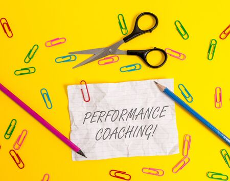 Writing note showing Perforanalysisce Coaching. Business concept for Facilitate the Development Point out the Good and Bad Crushed striped paper sheet scissors pencils clips colored background