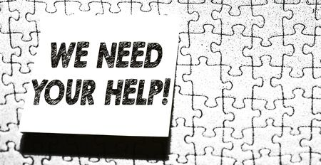 Word writing text We Need Your Help. Business photo showcasing asking someone to stand with you against difficulty Piece of square note paper use for give notation stick to puzzle background