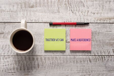 Text sign showing Together We Can Make A Difference. Business photo text be very important some way in like team or group Stationary placed next to a cup of black coffee above the wooden table