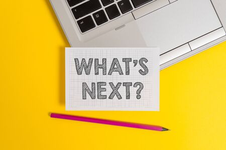 Handwriting text writing What S Next Question. Conceptual photo Get information Ask Query Investigate Probes Explore Top trendy metallic laptop pencil squared paper sheet colored background