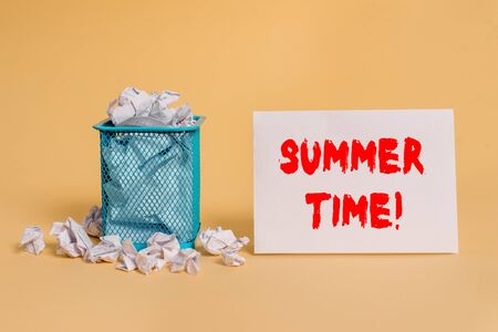 Handwriting text Summer Time. Conceptual photo achieve longer evening daylight summer setting clocks hour ahead crumpled paper trash and stationary with empty paper placed in trash can