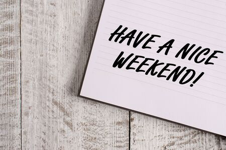 Conceptual hand writing showing Have A Nice Weekend. Concept meaning wishing someone that something nice happen holiday Notebook stationary placed above classic wooden backdrop