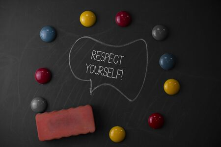 Handwriting text writing Respect Yourself. Conceptual photo believing that you good and worthy being treated well Round Flat shape stones with one eraser stick to old chalk black board 写真素材