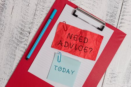 Writing note showing Need Advice Question. Business concept for Asking someone if he want recommendations or guidance Clipboard paper sheet crushed sticky note clip marker wooden background
