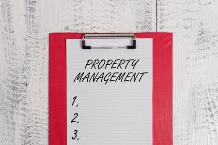 Text sign showing Property Management. Business photo text Overseeing of Real Estate Preserved value of Facility Colored clipboard blank paper sheet old retro wooden vintage background Stock Photo