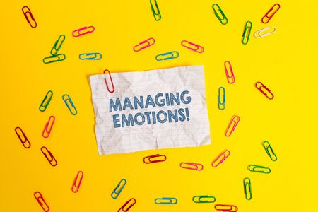 Text sign showing Managing Emotions. Business photo showcasing ability be open to feelings and modulate them in oneself Blank crushed paper sheet message clips binders plain colored background