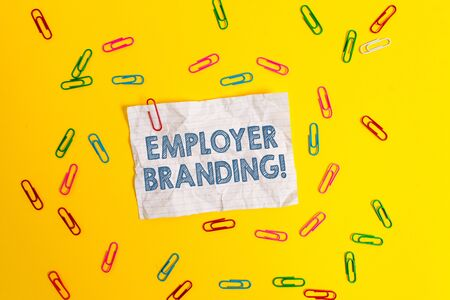 Text sign showing Employer Branding. Business photo showcasing promoting company employer choice to desired target group Blank crushed paper sheet message clips binders plain colored background