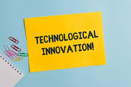 Text sign showing Technological Innovation. Business photo showcasing New Invention from technical Knowledge of Product Plain cardboard and writing equipment placed above pastel colour backdrop