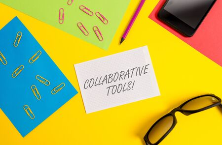 Text sign showing Collaborative Tools. Business photo text Private Social Network to Connect thru Online Email Paper sheets pencil clips smartphone eyeglasses notebook color background