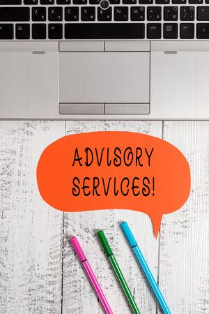 Handwriting text writing Advisory Services. Conceptual photo Support actions and overcome weaknesses in specific areas Open laptop blank speech bubble pens ballpoints lying vintage wooden table