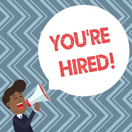 Conceptual hand writing showing You Re Hired. Concept meaning Used by huanalysis resources indicate employee that he is got job Young Man Shouting in Megaphone Floating Round Speech Bubble