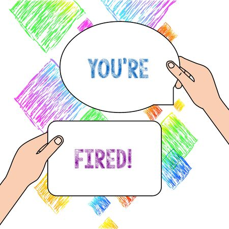 Text sign showing You Re Fired. Business photo text Used by boss indicate employee that he is discharged from job Two Blank Figured Tablets Signs Held in Hands One Above Other Text Space Stock Photo