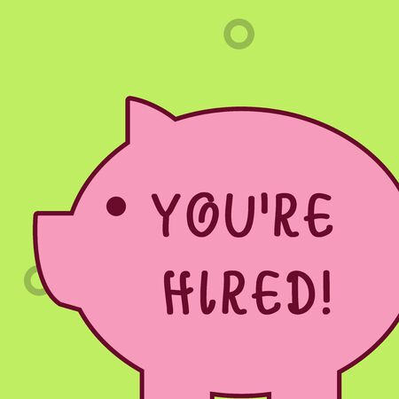 Handwriting text writing You Re Hired. Conceptual photo Used by huanalysis resources indicate employee that he is got job Fat huge pink pig plump like piggy bank with sharp ear and small round eye Фото со стока