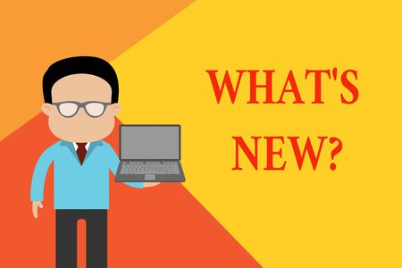 Handwriting text What S New Question. Conceptual photo Asking about latest Updates Trends Happening News Standing man in suit wearing eyeglasses holding open laptop photo Art