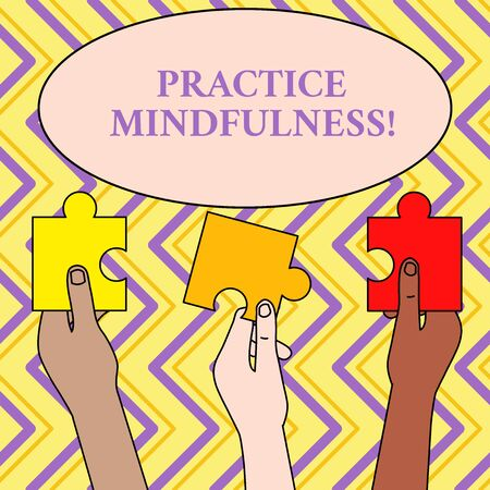 Writing note showing Practice Mindfulness. Business concept for achieve a State of Relaxation a form of Meditation Three Colored Empty Jigsaw Puzzle Pieces Held in Different People Hands Imagens