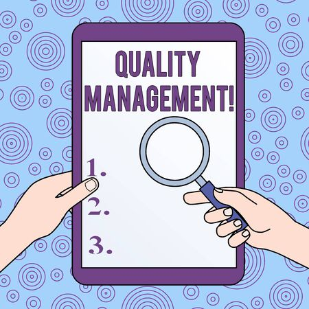 Conceptual hand writing showing Quality Management. Concept meaning Maintain Excellence Level High Standard Product Services Hands Holding Magnifying Glass Against Switched Off Tablet
