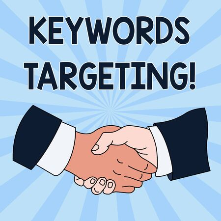 Conceptual hand writing showing Keywords Targeting. Concept meaning Use Relevant Words to get High Ranking in Search Engines Hand Shake Multiracial Male Colleagues Formal Shirt Suit