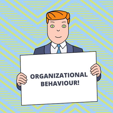 Text sign showing Organizational Behaviour. Business photo showcasing the study of the way showing interact within groups Smiling Man Holding Formal Suit Big Blank Poster Board in Front of Himself
