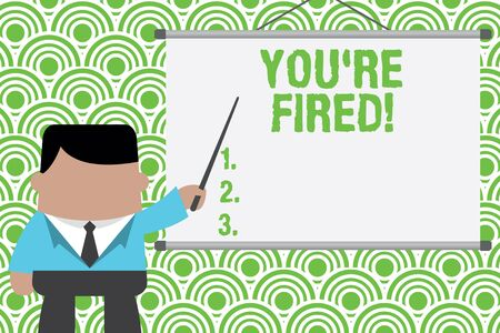 Text sign showing You Re Fired. Business photo text Used by boss indicate employee that he is discharged from job Businessman standing in front projector screen pointing project idea Stock Photo