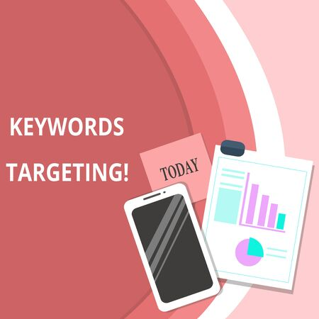 Handwriting text Keywords Targeting. Conceptual photo Use Relevant Words to get High Ranking in Search Engines Layout Smartphone Off Sticky Notes Clipboard with Pie Chart and Bar Graph
