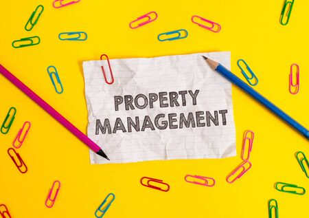 Conceptual hand writing showing Property Management. Concept meaning Overseeing of Real Estate Preserved value of Facility Blank crushed paper sheet message pencils colored background