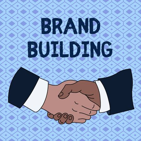 Handwriting text Brand Building. Conceptual photo Generating awareness Establishing and promoting company Hand Shake Multiracial Male Business Partners Colleagues Formal Shirt Suit