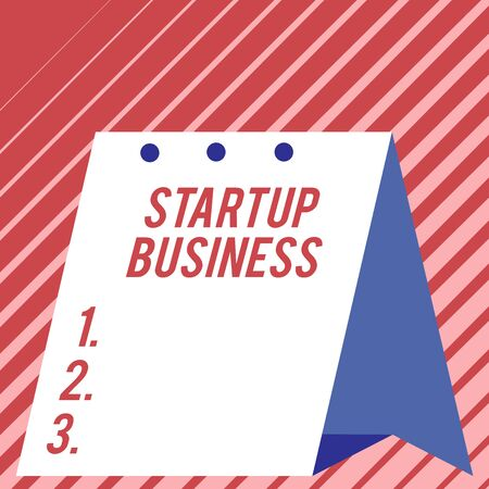 Text sign showing Startup Business. Business photo showcasing Engaging to a New Venture Fresh Trading and Selling Modern fresh and simple design of calendar using hard folded paper material Zdjęcie Seryjne