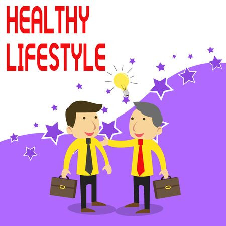 Handwriting text writing Healthy Lifestyle. Conceptual photo Live Healthy Engage in physical activity and exercise Two White Businessmen Colleagues with Brief Cases Sharing Idea Solution