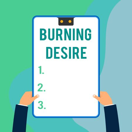 Conceptual hand writing showing Burning Desire. Concept meaning Extremely interested in something Wanted it very much Two executive male hands electronic device geometrical background 스톡 콘텐츠