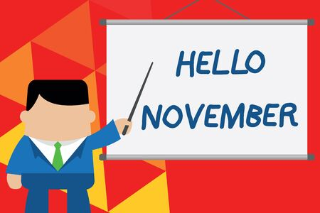Conceptual hand writing showing Hello November. Concept meaning Welcome the eleventh month of the year Month before December Businessman standing in front projector pointing project idea Foto de archivo - 124656185