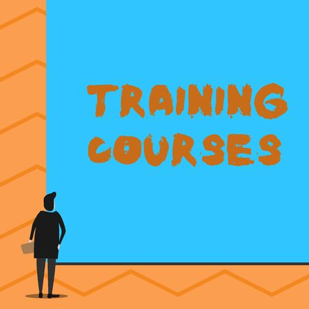 Text sign showing Training Courses. Business photo text is series of lessons or lectures teaching skills you need Man stands in back view in front of huge empty blank big rectangle board