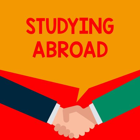 Word writing text Studying Abroad. Business photo showcasing learn outside of home in foreign country Travelling Two persons have bubbly conversation while greet each other and shake hands