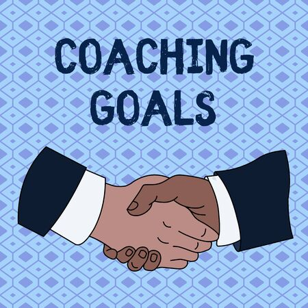 Handwriting text Coaching Goals. Conceptual photo Empowers individuals Encourages them to take responsibility Hand Shake Multiracial Male Business Partners Colleagues Formal Shirt Suit