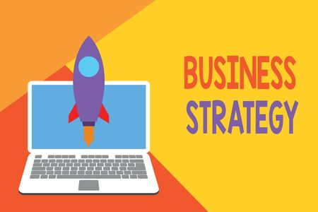 Text sign showing Business Strategy. Business photo showcasing Management game plan to achieve desired goal or objective Launching rocket up laptop . Startup project. Developing goal objectives