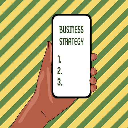 Handwriting text Business Strategy. Conceptual photo Management game plan to achieve desired goal or objective Closeup of Smartphone Device Held in Hand with Empty Screen and Text Space Banco de Imagens - 124656525