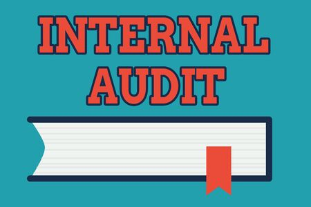 Text sign showing Internal Audit. Business photo text Evaluates the effectiveness of the controls and processes Side View of Closed Book on Table Desk with Red Bookmark Ribbon Isolated