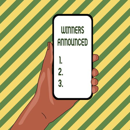 Handwriting text Winners Announced. Conceptual photo Announcing who won the contest or any competition Closeup of Smartphone Device Held in Hand with Empty Screen and Text Space Stock Photo