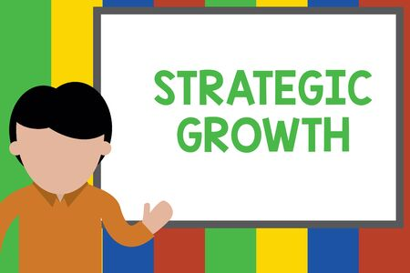 Writing note showing Strategic Growth. Business concept for create plan or schedule to increase stocks or improvement Young man standing in front whiteboard pointing to project. photo Art