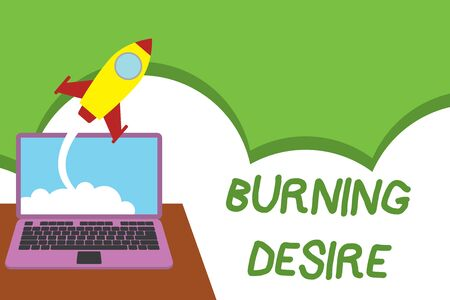 Text sign showing Burning Desire. Business photo showcasing Extremely interested in something Wanted it very much Successful rocket launching clouds out laptop background. Startup growing Banco de Imagens