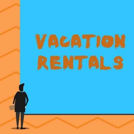 Text sign showing Vacation Rentals. Business photo text Renting out of apartment house condominium for a short stay Man stands in back view in front of huge empty blank big rectangle board Reklamní fotografie